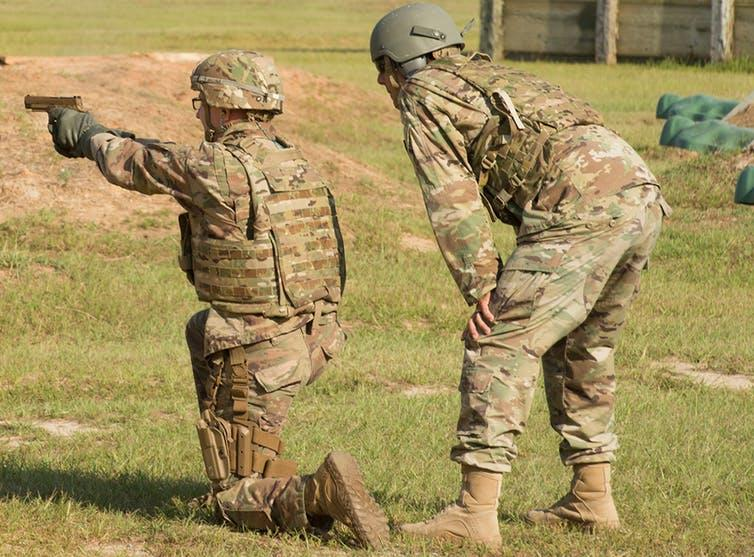 A soldier fires the Sig Sauer P320, which the Army has chosen as its new standard pistol.
